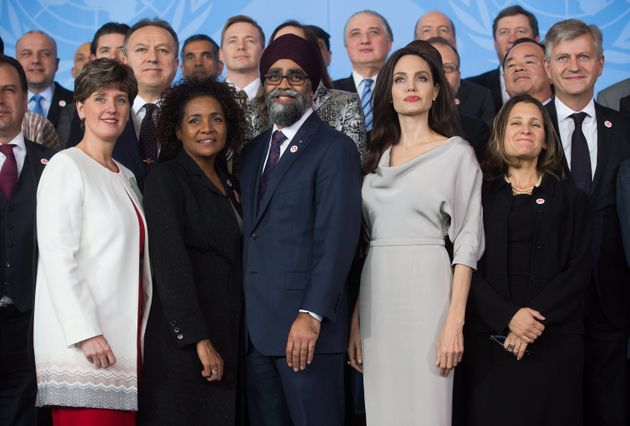 Angelina Jolie, front row 4th left, poses with delegates during the family photo at the 2017 United Nations...
