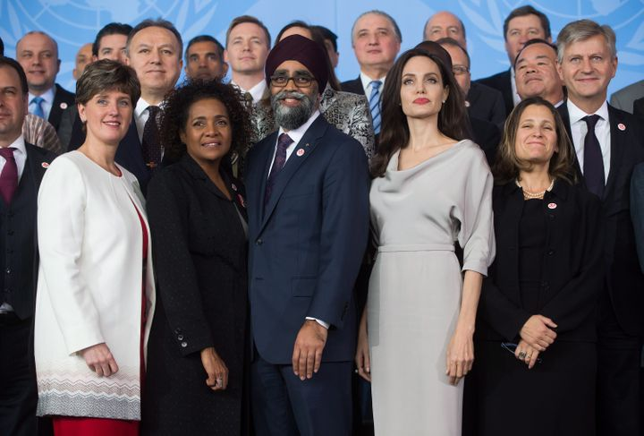 Angelina Jolie, front row 4th left, poses with delegates during the family photo at the 2017 United Nations Peacekeeping Defence Ministerial conference in Vancouver on Wednesday. Standing in the front row with her, from left to right, are Minister of International Development Marie-Claude Bibeau, Secretary General of La Francophonie Michaelle Jean, Defence Minister Harjit Sajjan and Minister of Foreign Affairs Chrystia Freeland.