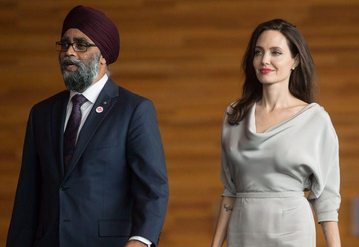 Defence Minister Harjit Sajjan, left, and UNHCR Special Envoy Angelina Jolie