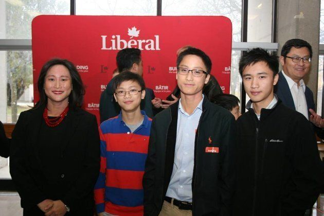 Jean Yip poses with her sons Theodore, Ethan, and Nathaniel on Nov. 12,
