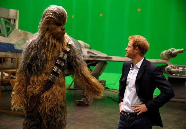 Prince Harry meets Chewbacca during a visit to the Star Wars film set at Pinewood Studios in April