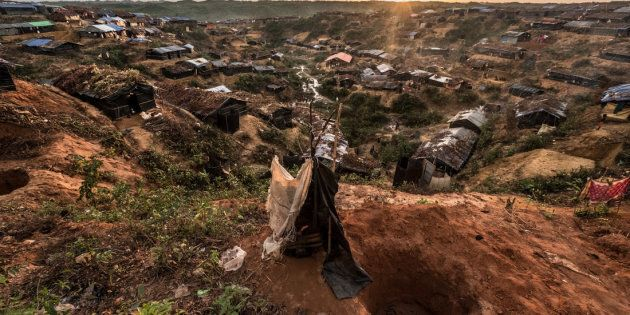 In Rohingya refugee camps in Bangladesh, people dig holes for as many as 10-15 families to use as makeshift