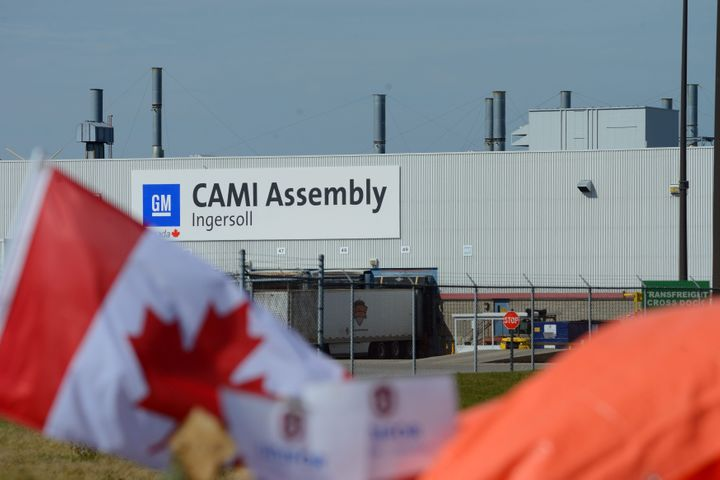 A Canadian flag flies while workers represented by Unifor are on the picket lines of the General Motors CAMI Assembly plant in Ingersoll, Ont. on Saturday, Oct. 7, 2017.
