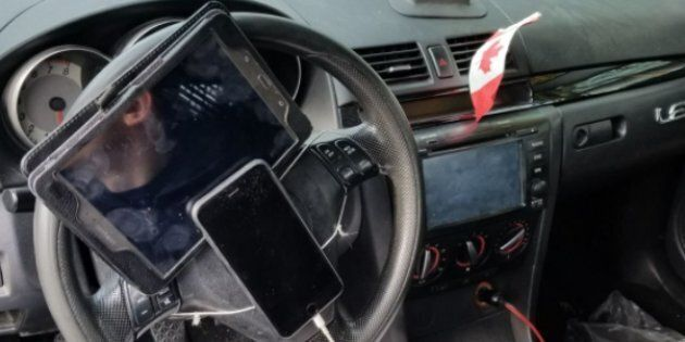 Police in Vancouver caught a driver who'd strapped a tablet and iPhone to his steering wheel.