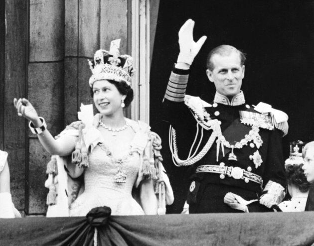 Queen Elizabeth II accompanied by Prince Philip waves to the crowd in June 1953 after being crowned solemnly at Westminter Abbey.