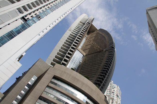 The Trump Ocean Club International Hotel and Tower Panama is seen between apartment buildings in Panama City, Panama October 11, 2017.