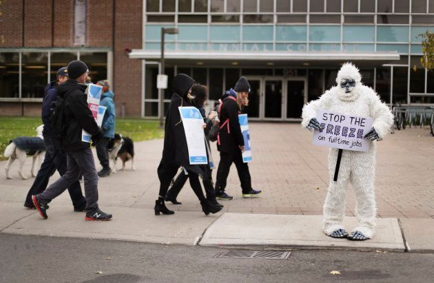 An instructor is dressed up as a Yeti while she walks the picket line at the East York Centennial College