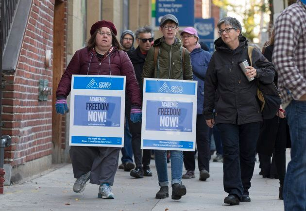 Striking teachers at George Brown College make their way along King