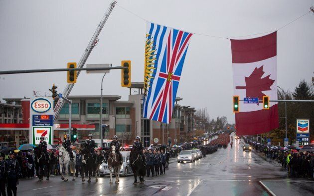 The funeral procession carrying the body of Abbotsford Police Const. John Davidson, who was killed in...