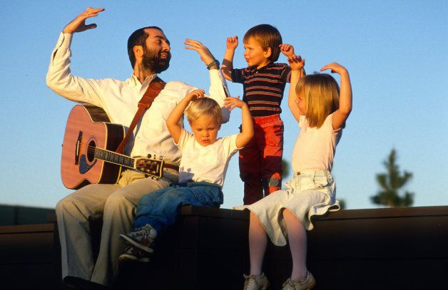 Raffi entertains some children after a concert Sept. 10, 1989.