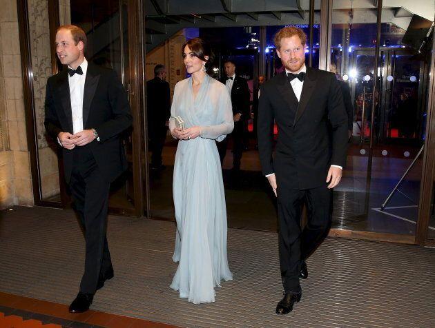 Prince William, Duke of Cambridge, Catherine, Duchess of Cambridge, and Prince Harry (R) attend The Cinema...