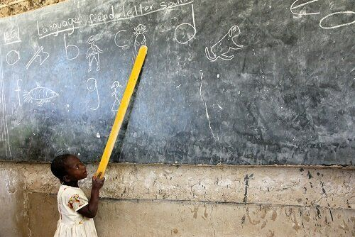 A young student takes part in lessons in Kenya.