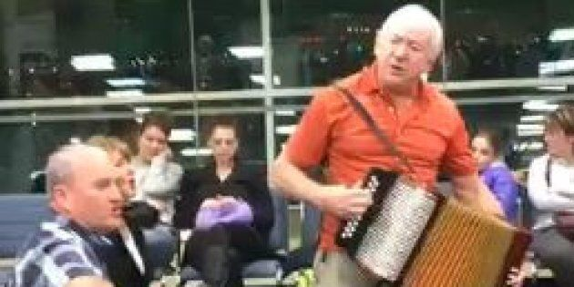 Musicians Sean Sullivan and Sheldon Thornhill busted out their instruments to entertain the crowd waiting...