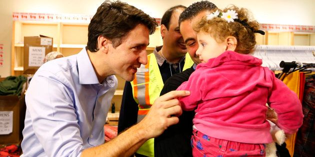 Syrian refugees are greeted by Prime Minister Justin Trudeau on their arrival from Beirut at the Toronto...