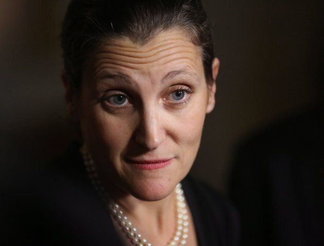 Foreign Affairs Minister Chrystia Freeland talks to reporters outside the House of Commons in Ottawa...