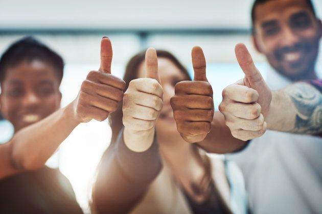 Cropped shot of a team of colleagues showing thumbs up at