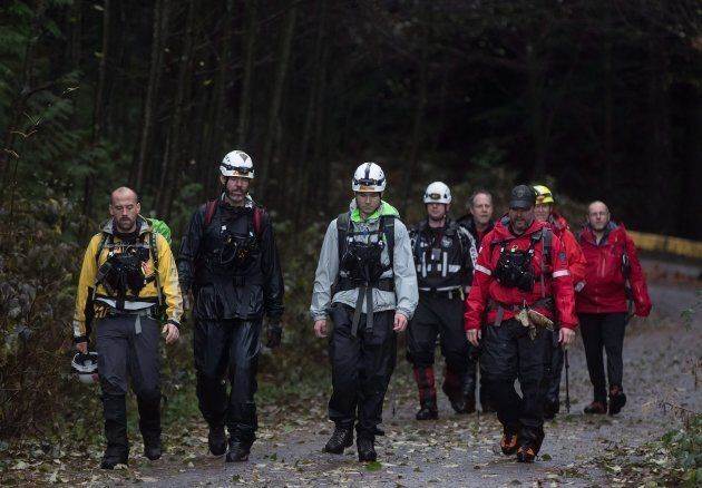 Search and rescue volunteers exit a trail on Eagle Mountain after Annette Poitras was found in Coquitlam,...