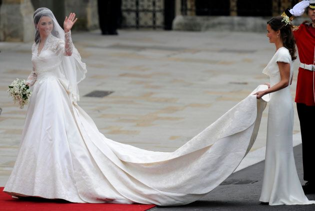 Kate Middleton waves as she arrives at the West Door of Westminster Abbey in London for her wedding to...