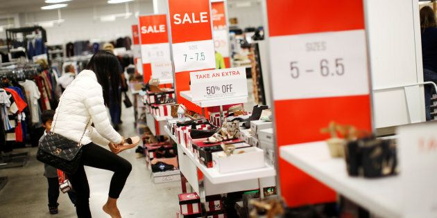 A woman tries on shoes at a Sears store in Oakville, Ontario, Canada, October 6,