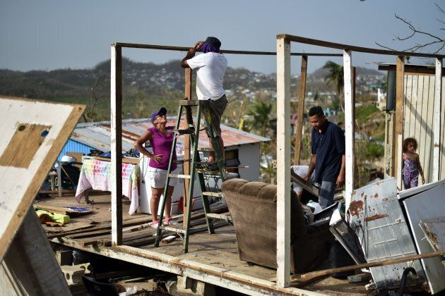 Wilson Hernandez and his family rebuild their house destroyed by Hurricane Maria in Puerto Rico on Sepp....
