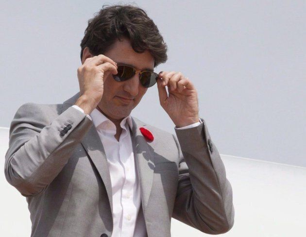 Prime Minister Justin Trudeau removes his sunglasses as he arrives in Ho Chi Minh City, Vietnam on Nov....