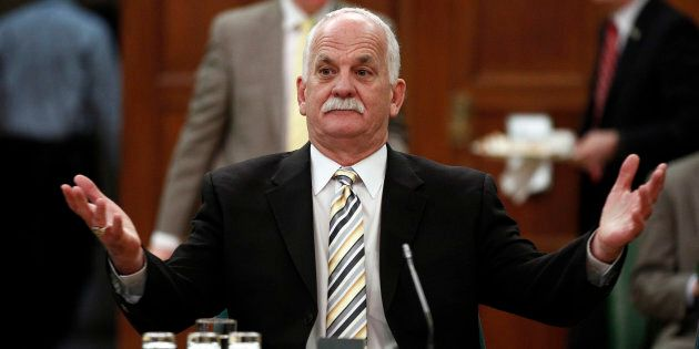 Former public safety minister Vic Toews gestures before the Commons procedure and House affairs committee...