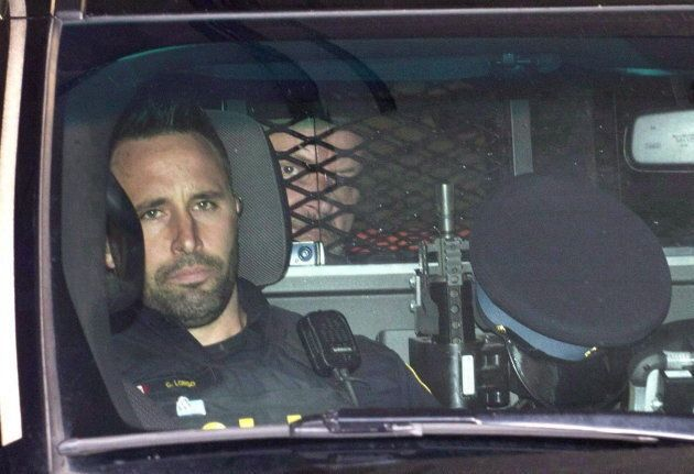 Basil Borutski leaves in a police vehicle after appearing at the courthouse in Pembroke, Ont., on Sept....