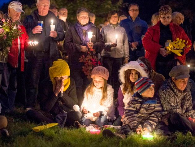 Mourners hold a candlelit vigil in remembrance of Carol Culleton, Anastasia Kuzyk and Natalie Warmerdam...