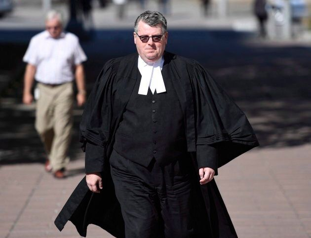Crown Attorney Jeffery Richardson walks towards the Ottawa Courthouse following jury selection for the...