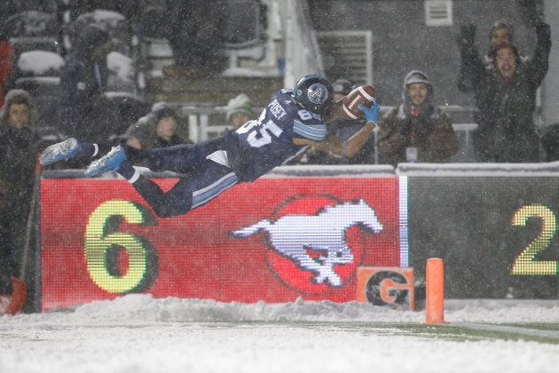 Toronto Argonauts' DeVier Posey scores a touchdown against the Calgary Stampeders during the Canadian...