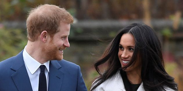 Britain's Prince Harry poses with Meghan Markle in the Sunken Garden of U.K.'s Kensington Palace, November...