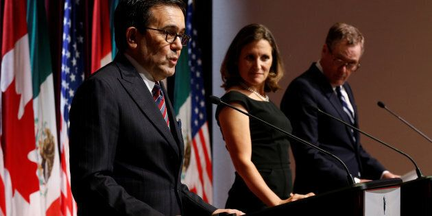 Mexico's Economy Minister Ildefonso Guajardo (left) addresses the media with Canada's foreign minister,...