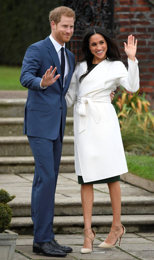 Britain's Prince Harry poses with Meghan Markle in the Sunken Garden of Kensington Palace, London, Britain,...