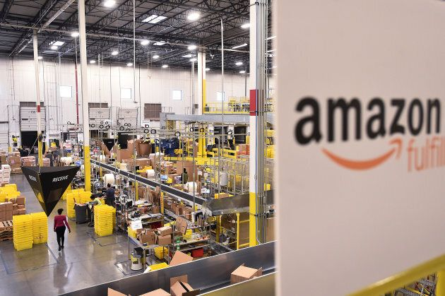 Workers process incoming items at an Amazon Fulfillment Center on Cyber Monday in Tracy, Calif., Nov....