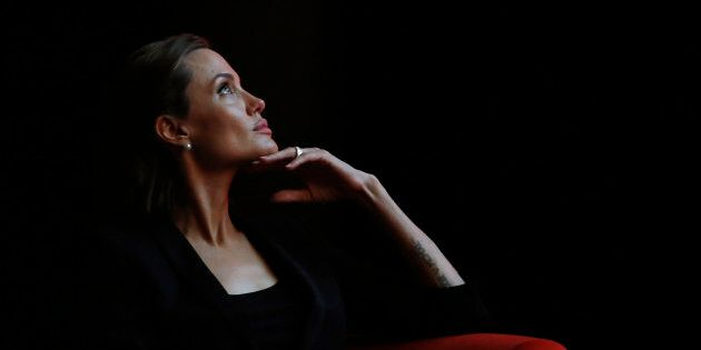 Actress and campaigner Angelina Jolie attends a summit to end sexual violence in conflict on  June 12, 2014.