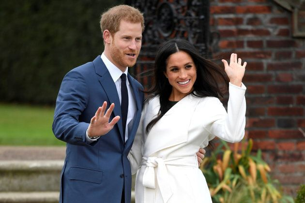 Prince Harry poses with Meghan Markle in the Sunken Garden of Kensington Palace, London, Britain, Nov. 27, 2017.