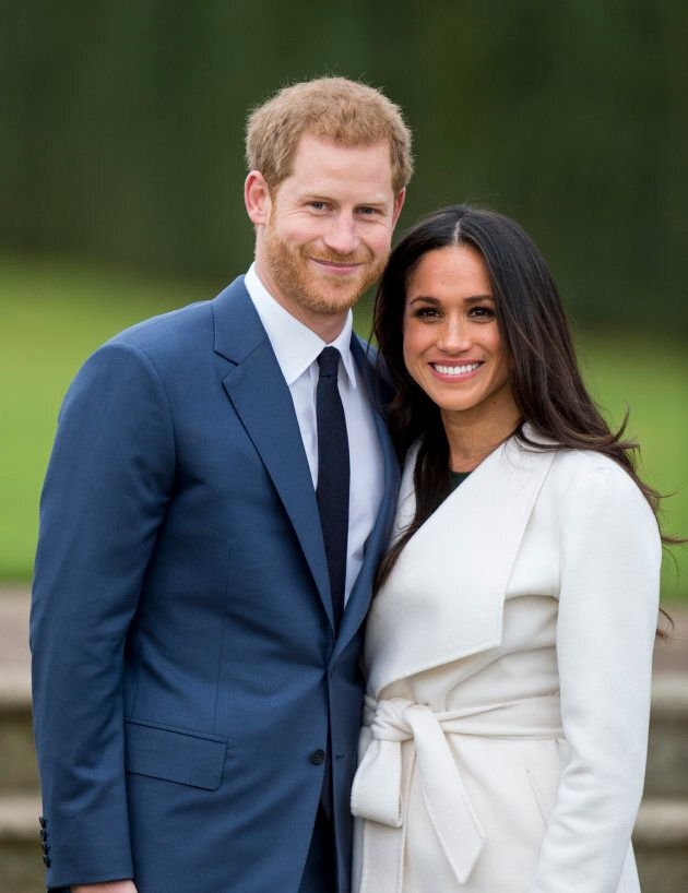 Prince Harry and Meghan Markle pose during an official photocall to announce the engagement of Prince...