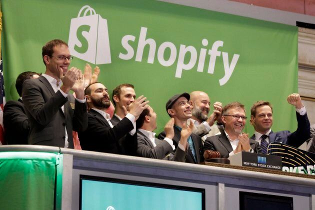 Shopify CEO Tobias Lutke, center wearing hat, is celebrated as he rings the New York Stock Exchange opening...