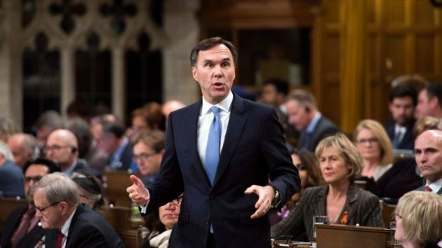 Finance Minister Bill Morneau stands during question period in the House of Commons on Parliament Hill...