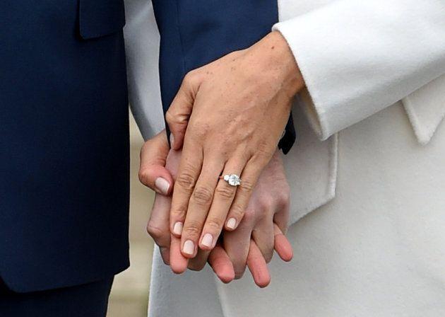 Prince Harry poses with Meghan Markle at Kensington Palace, Nov.