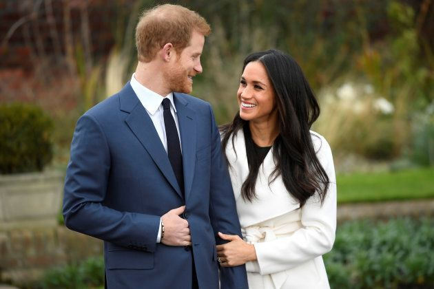 Prince Harry poses with Meghan