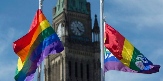The pride flags fly on Parliament Hill following a ceremony with Prime Minister Justin Trudeau on June...