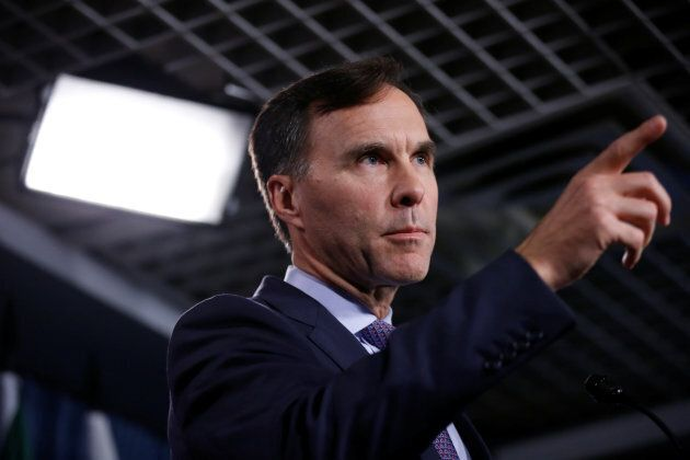 Finance Minister Bill Morneau gestures during a news conference on Parliament Hill on Oct. 19,
