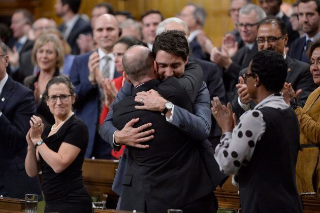 Prime Minister Justin Trudeau hugs Liberal MP Randy Boissonnault in the House on Nov. 28,