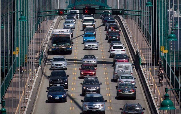 Traffic crosses over the Lions Gate Bridge from North Vancouver into Vancouver, July 2,