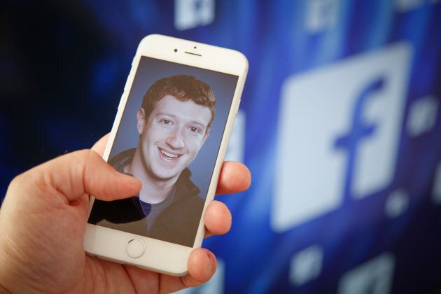 A portrait of Facebook founder Mark Zuckerberg is seen on an iPhone in this photo on August 28,