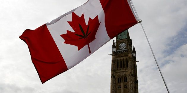 A Canadian flag with a marijuana leaf on it is seen during the annual 4/20 marijuana rally on Parliament Hill in Ottawa on April 20, 2017.