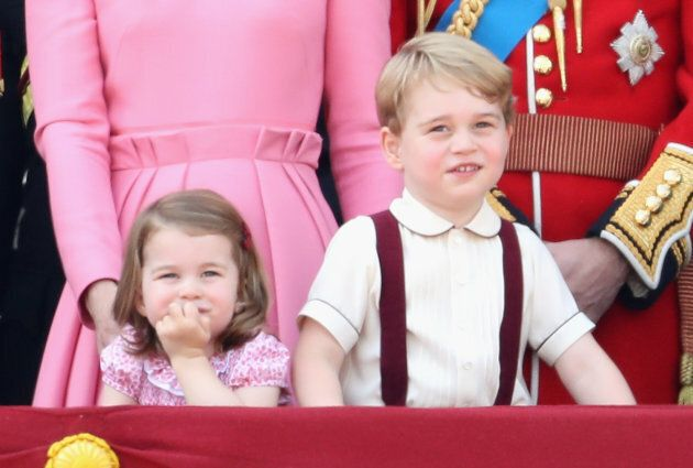 Princess Charlotte and Prince George look out from the balcony of Buckingham Palace during the Trooping...