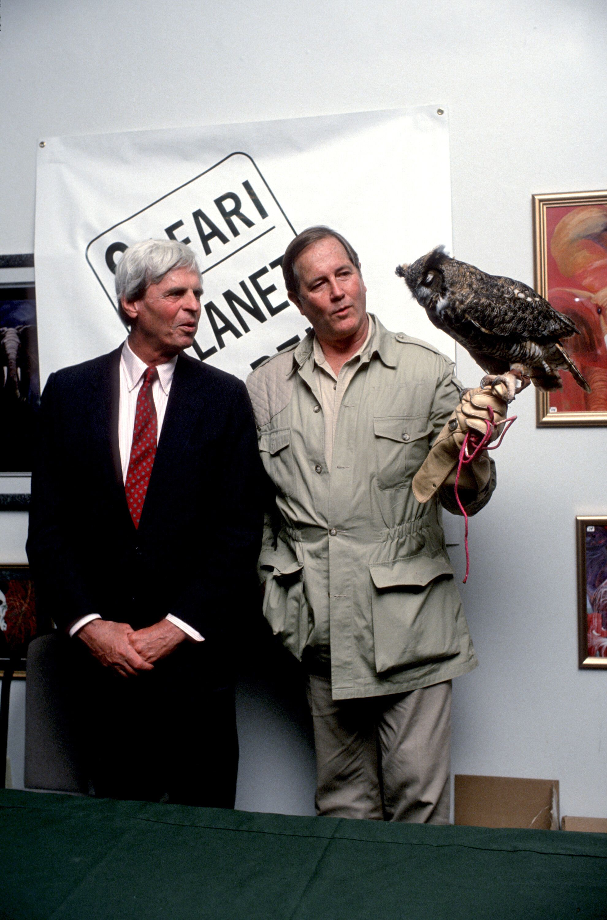 Journalist George Plimpton, left, and Jim Fowler with owl.
