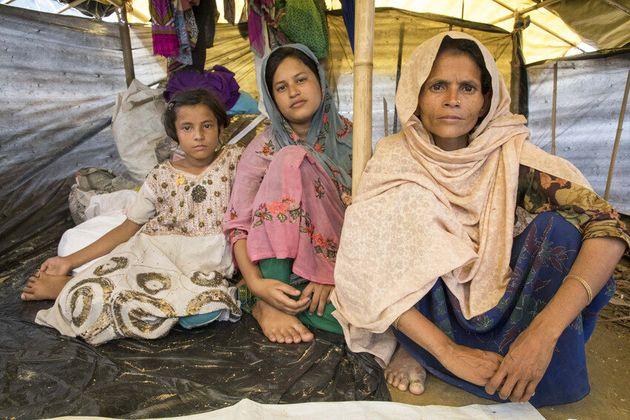 Jaheda, 35, and her daughters Zohara, 10, and Senowara, 18, in their